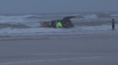 Three children rescued from car plunging into the ocean