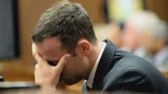 Pistorius trial: Oscar Pistorius throws up in court