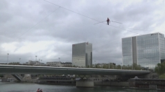 Tightrope walker completes walk over river Seine in Paris
